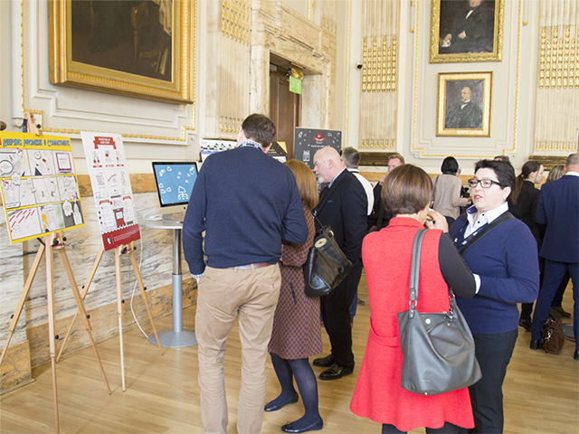 Delegates gather at the design stand