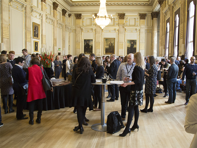 Delegates mingle in the Great Hall